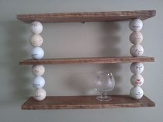 Upcycled Shelf. (made with reclaimed wood and used golf balls)