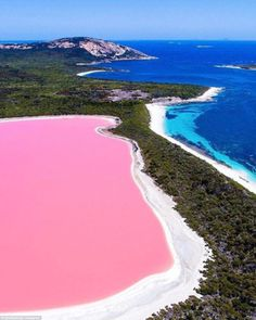 Stunning drone images have captured extraordinary new perspectives of Australia's most famous landmarks. Pictured, the pink water of Lake Hillier in Western Australia