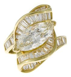 A diamond ribbon motif ring  central marquise-cut diamond weighing approximately: 1.75 carats; remaining diamonds weighing approximately: 1.70 carats total; mounted in eighteen karat gold;