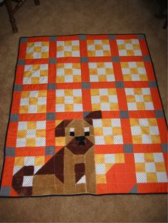 """Quilt made for my grandson.  It's from the book, """"Guess Who's On My Quilt?"""" by Billie Lauder (2nd edition).  Look closely and you'll see that the dog's body is made from pieces within the quilt blocks.  The tongue was tripled stitched knowing that that was probably going to be the """"handle."""""""