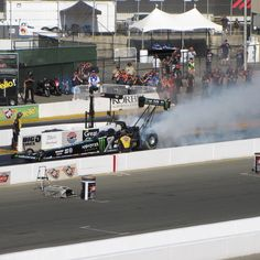 Brittany Force doing her burnout at the 2015 NHRA Drag Races in Sonoma , CA.