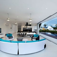 Modern home in Colombia built for entertaining. Living room opens up the living space to the beautiful side yard pool.