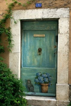 French country house ~ The cat and flower pot are painted in trompe l'oeil and almost appear to be real.