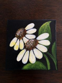 Hand painted mini canvas magnet of white with yellow daisies on black background. Size 3x3 on Etsy, $19.99
