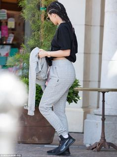 Casual style: Kylie kept it simple when it came to her outfit, sporting a black T-shirt and grey sweatpants