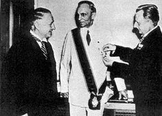 Henry Ford allowing himself to be used by the Nazi machine, happy and proud to receive his medal from the Reich.
