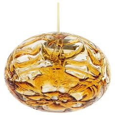 Doria Pendant Light, Textured Amber Glass Globe and Brass, 1960s | From a unique collection of antique and modern chandeliers and pendants at https://www.1stdibs.com/furniture/lighting/chandeliers-pendant-lights/