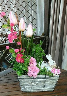 A Box of easter and spring decorations. Pink