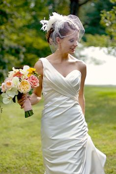 Love the dress and the bouquet..