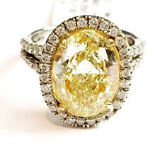 There's just something about a Canary Yellow diamond... Natural Fancy Yellow 4ct GIA oval diamond ring. @indyfacets #indyfacets #luxurylife #indianapolis #indystyle #dreamring #haloring #engagementring