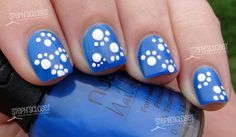 Blue and White Paw Print Nail Art http://www.stephscloset.com/blog/beauty/2012/04/790/nail-art-tutorial-wildcat-paw-print/#
