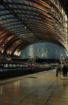 Liverpool Lime Street station, Liverpool. The iron and glass roof dates from the 1880's. This has the most beautiful and usual curved layout and is so open and bright.