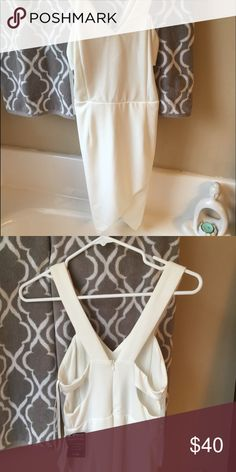 White Asymmetrical Body con Dress Brand new. Never fit me. Bought from boutique in Miami. Has tags. Dresses Asymmetrical