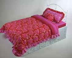 EASY – this doll bed is made from a basket and a piece of wire garden trim. For the complete tutorial, check out Make this Quick and Easy Doll Bed from Doll Clothes Patterns.