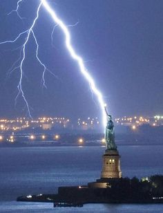 Lightning strikes the Statue of Liberty ~ from Amazing Photos of the World.