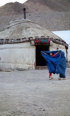 Playing with the smûk scarfs at the yurt in Tajikistan.