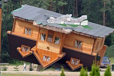 """Strange-looking buildings around the world. This is the """"Upside Down House"""" in Poland. What is up with these crazy Polish?"""