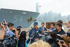 HONG KONG(Nov.12,2013)Capt.TomDisy,CO of Ticonderoga-class guided-missile cruiser USS Antietam(CG 54)speaks to media about Antietam & George Washington Carrier Strike Group's plans to provide humanitarian relief to Philippines in response to Super Typhoon Haiyan/Yolanda.Carrier Group will be able to provide humanitarian assistance,supplies,& medical care in support of efforts led by government & military of Republic of Philippines.(USN Mass Comm Spec 3rd Class Declan Barnes)