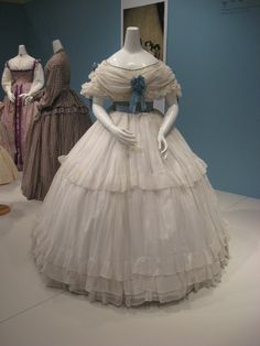 2012-08-25 KSMF - Sheer white cotton dress with blue satin sash (French), circa 1860.