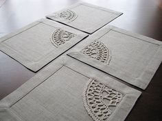 Set of 4 square table napkins from natural color linen fabric with crocheted linen yarn applique. Handmade. Very versatile size: mini placemat or maxi coaster. Double, with mitered corners classic border (3 cm.) Aplique stitched by sewing machine. Perfect gift.  Square 9 2/4 (24 cm.)  *pure natural linen color (linen grey) fabric. *pure natural linen yarn. *delicate machine or hand wash.  The colors of the item may vary slightly due to different computer monitor settings.  ONLY ONE SET OF 4…