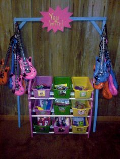 Prize section we made for Kelsey's carnival birthday party :)  Bought the inflatable guitars from Amazon for $7!