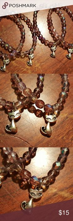 YAY CATS! Magen's Fairytale Creations originals. My mom makes the best handmade jewelry.  She is sharing all of her kitty themed jewelry with me to help me save up for a special dress.   These are all glass beads on heavy stretch cord. With a super cute silver cat charm. I have 4 available.  Please know that she spends hours on all of her creations and only uses the best beads.   Firm on the price but you can bundle. Thank you Magen's Fairytale Creations  Jewelry Bracelets