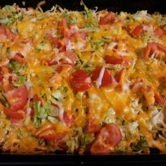 Layer ingredients in 9 x 13 pan as listed - crushed chips, meat and seasonings, 2/3 of cheese, lettuce, tomato, and remaining cheese.