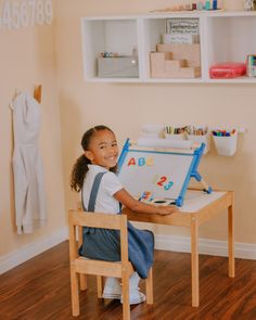 Inspire endless creativity with this double-sided tabletop easel, featuring a magnetic dry-erase board on one side, and a chalkboard on the other. The included paper-roll holder with a paper guide and tear-bar accommodates 12-inch paper rolls and adds even more ways to create masterpieces! The deluxe set comes with a dry-erase marker and felt eraser, five colored chalk sticks, a 50-foot-long paper roll, 36 letter and number magnets, and an art supply tray. Paper Roll Holders, Colored Chalk, Dry Erase Markers, Dry Erase Board, Educational Activities, Easel, Chalkboard, Flip Charts, Whiteboard