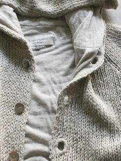 sweater lined with jersey and those buttonholes! vlas blomme