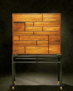 Illum Wikkelsø; Rosewood, Lacquered Wood  and Brass Cabinet by William Christensen for Illums Bolighus 1950s.