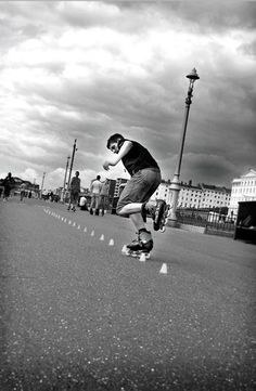 in-line skater doing tricks on Brighton seafront. Asmartartz Photography