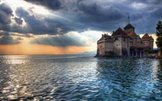 Chillon Castle is an island castle located on Lake Geneva (Lac Leman), south of Veytaux in the canton of Vaud. Chillon is amongst the most visited castles in Switzerland and Europe. According to the castle website, Chillon is listed as Monuments, Guggenheim Museum Bilbao, Amoled Wallpapers, Foto 3d, Fairytale Castle, Mont Saint Michel, Travel Wallpaper, Lake Geneva, Best Cities