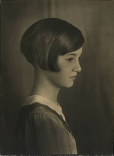 A young girl with a short, bobbed hairstyle, 1930-1937.