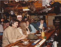 Raise a glass! This photo was taken at Shrimp's in Boulder Junction in the early 1980s. The bar is now known as Gooch's.