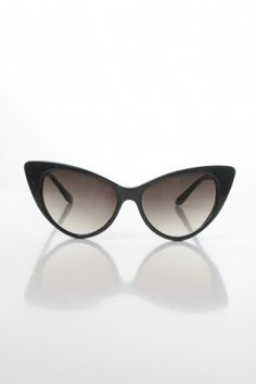 Awesome 60's-inspired cat eye sunnies finished with a gradient lens. 100% UV protection.    Plastic  Wipe     Clean  Imported