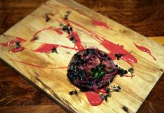 Scratch Bar gastropub: Cured pig's head, a blend of tongue and cheek, served atop beet must...