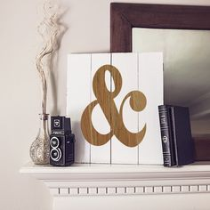 Celebrate the union that makes your house a home with this Personalized Rustic Ampersand Wooden Wall Art. It features a classic engraved ampersand design and free personalization on rich fir wood.