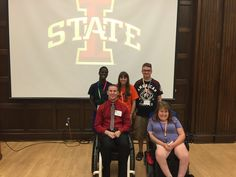 Chris Norton, bottom left, poses for a picture with four students who attended this week's Iowa Youth Leadership Forum for Students with Disabilities. Norton was the events keynote speaker Thursday. Photo by Sean Sears/Ames Tribune http://www.amestrib.com/news/ames-and-story-county/ylf-students-disabilities-has-iowa-hero-chris-norton-keynote