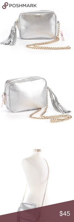 """Victoria's Secret Cross Body Bag w/Gold Hardware DESCRIPTION: Victoria's Secret Cross Body Bag with gold chain.   CONDITION: Brand new with tags.  MEASUREMENTS:   Size: One size - 6"""" Width, 8"""" Height, 2"""" Depth  Color: Silver & Gold Victoria's Secret Bags Crossbody Bags"""
