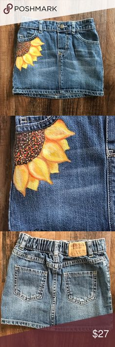 OshKosh Denim Skirt with Painted Sunflower 3T OshKosh denim skirt with hand painted Sunflower.  Upcycled   Size 3T, 99% cotton 1% spandex   Care Instructions: Machine wash and dry inside out.   Each piece is individually hand painted. One of a kind unique gift. OshKosh B'gosh Bottoms Skirts