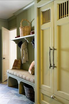 Mudroom. Great closet. Love the grating to allow air-circulation and the basket nooks under the bench cushion.