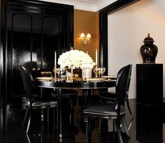 Ralph Lauren One Fifth art deco collection dining room. Black with touches of gold and crystal.