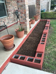 New cinder block flower bed.