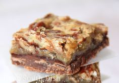 Classic Southern pecan pie bars with a touch of cocoa in the crust, a layer of melted chocolate, salted and roasted pecans, and a splash of bourbon in the filling... if you like.
