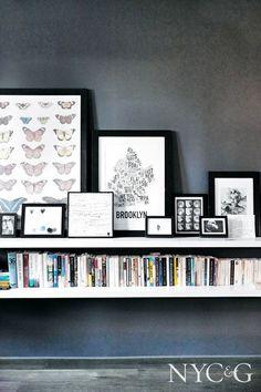 Leaning black frames make alternative gallery wall