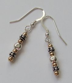 Silver and gold earrings by Jasmine Jewellery