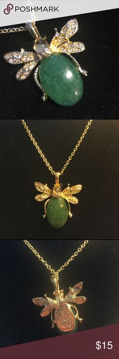 "Natural Stone Scarab Style Necklace Beautiful green natural stone with surrounding crystals define this gold-tone necklace.  Pendant size is 1 3/4 "" x 1 3/4"" at widest points.  14k gold plated chain is 24"" with 2"" extender.  New. Jewelry Necklaces"