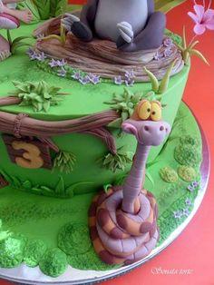 This Disney Jungle Book Cake features Mowgli and Baloo with Kaa in the jungle. Jungle Book Party, Jungle Cake, Tarzan, Disney Safari, 3rd Birthday Cakes, Book Cakes, Animal Cakes, Disney Cakes, Cakes For Boys