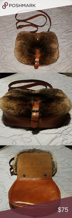 New💚Patricia Nash Chocolate Fur Leather Satchel Brand New without Tags. Fur and Leather Sides Snap for smaller use. Outside pocket on either side. Inside two seperate sides with zipper pocket and pouches. Lots of space in this MEDIUM sized satchel purse. FLAW IN LAST PICTURE- MISSING SMALL AMOUNT OF FUR IN FRONT (MILD BALD SPOT) Patricia Nash Bags Satchels