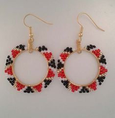 Handmade Native American beaded earrings, Digital Pines Market. Red, white, and gold Japanese lined seed beads and black cut-glass seed beads on a hammered brass hoop. Nickel free earring wires.